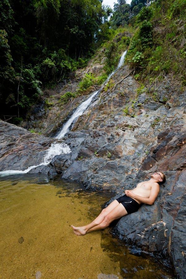 Tourist on Huai To waterfall stock image