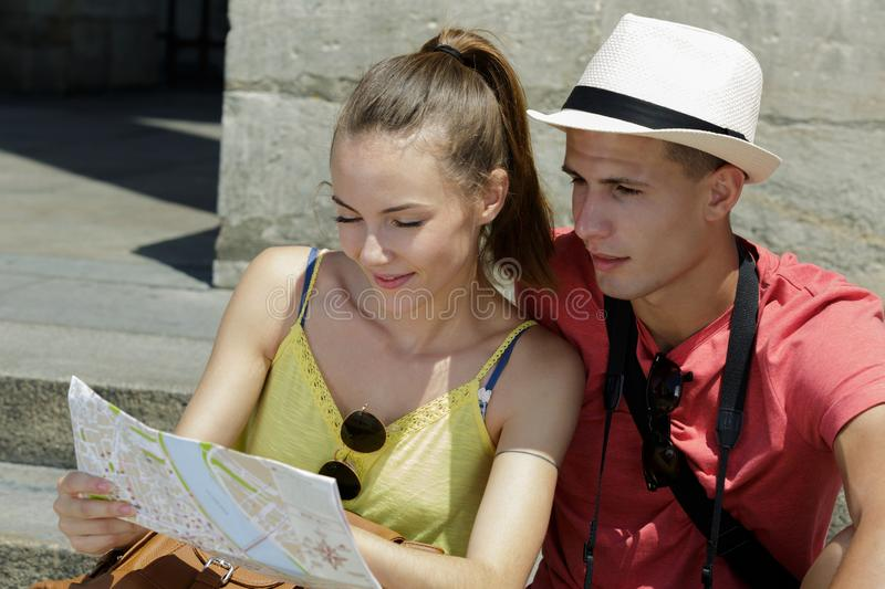 Young tourist looking at map. Young tourist looking at the map royalty free stock photography