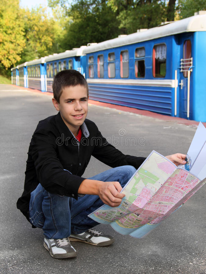 Download Young tourist with a map stock photo. Image of adolescent - 26625574