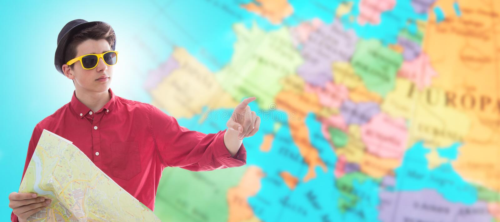 Young tourist with map and travel destinations stock photo