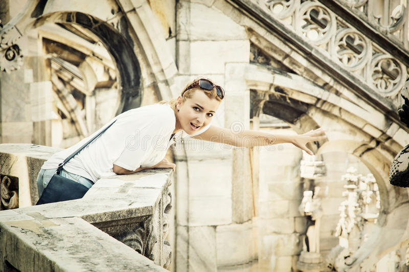 Young tourist woman on the Milan cathedral, Italy royalty free stock photography