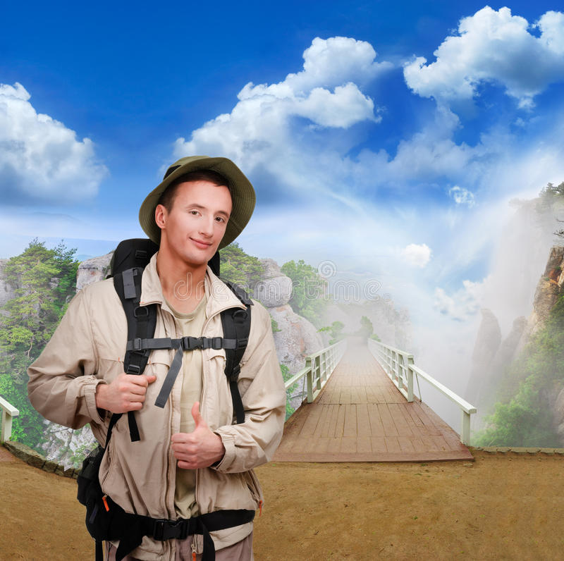 Young tourist on wooden bridge stock image