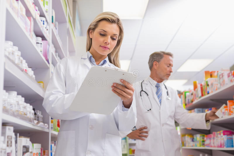 Young Trainee Writing On A Prescription Pad Stock Image - Image of ...