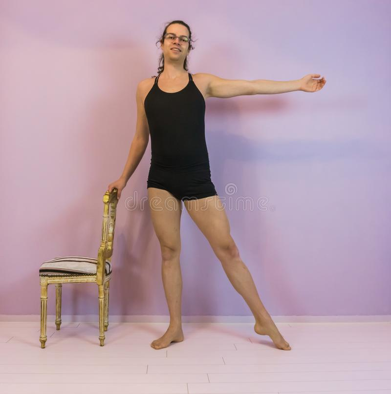 Young transgender girl practicing ballet, ronde jambe a classical dance move, LGBT in the dancing sport stock photos