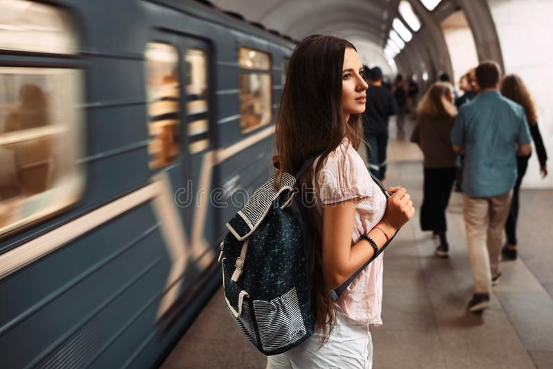 Young travel girl with the bag back in russian metro. Young travel girl with the bag back in russian metro stock photography