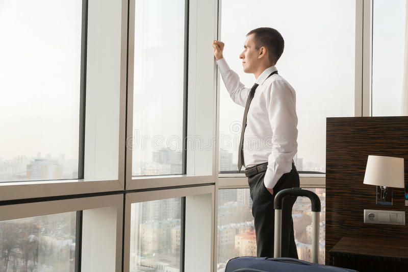 Young traveler businessman looking in window royalty free stock image