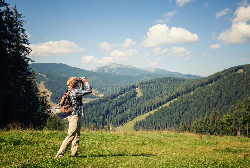 Young traveler enjoying mountain view. Young traveler enjoying mountain sunny view royalty free stock image