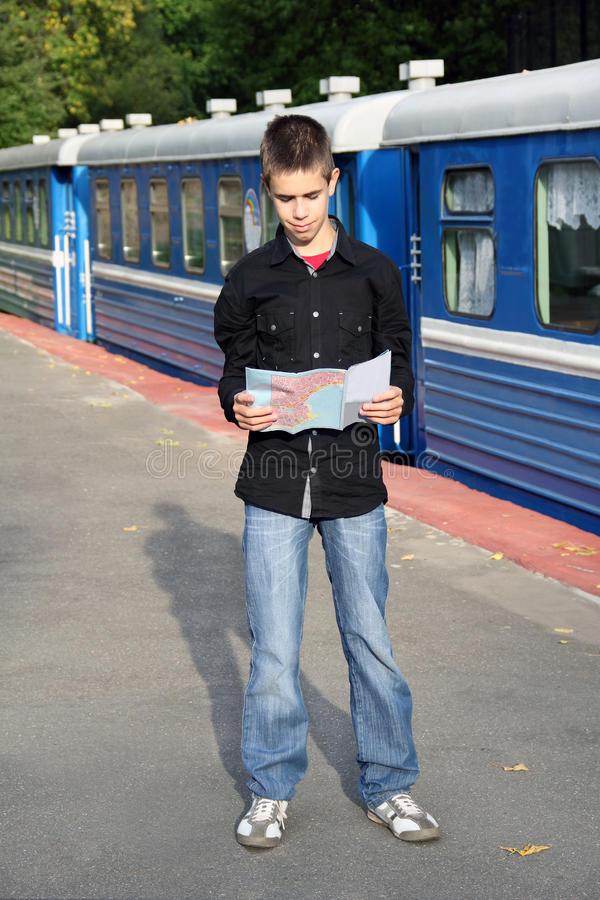 Young Traveler With A Map Stock Photography