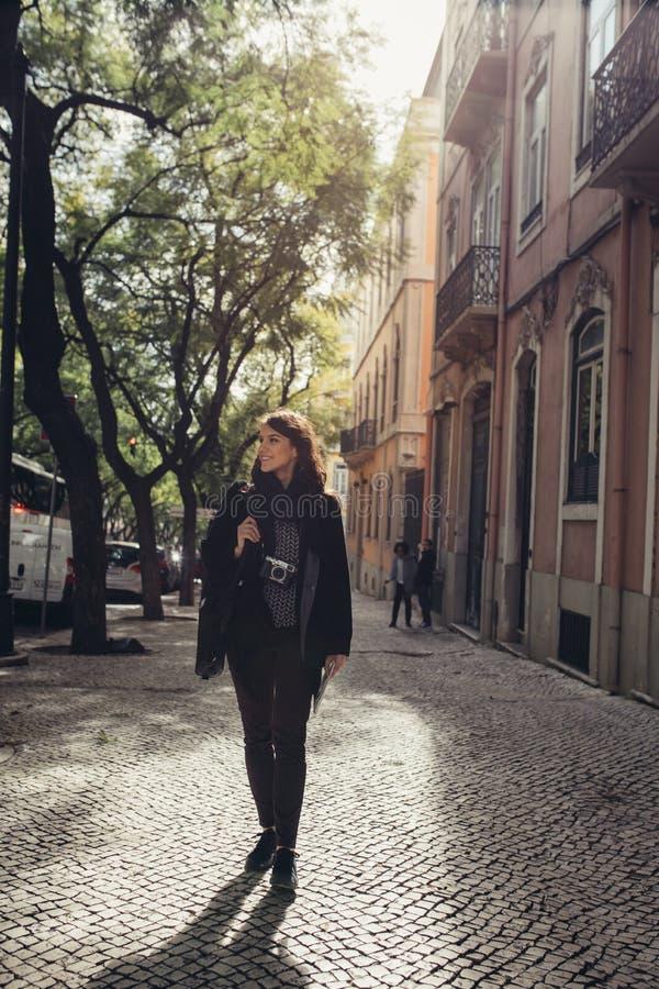 Young traveler woman admiring beautiful sunny narrow streets in Lisbon, Portugal stock photos