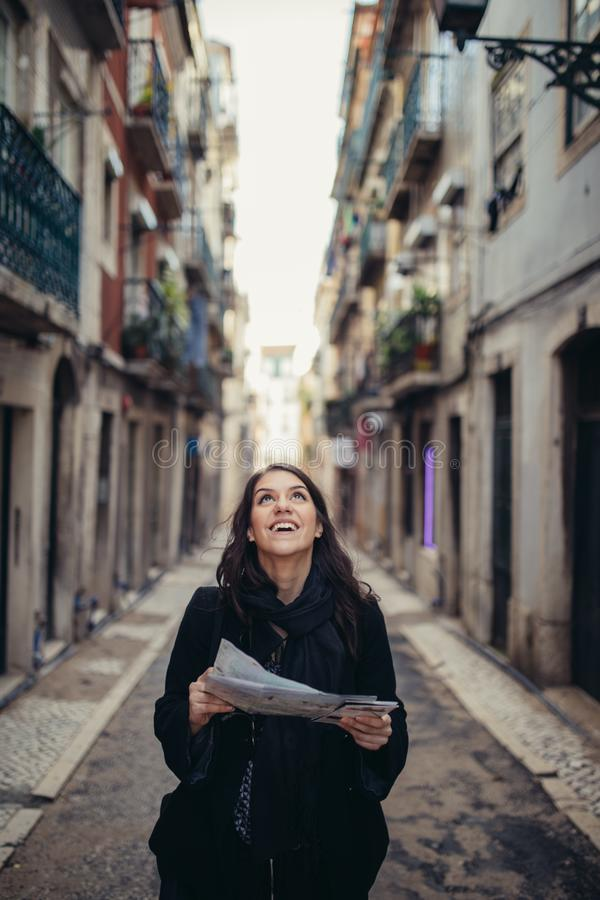 Young traveler woman admiring beautiful sunny narrow streets in Lisbon, Portugal royalty free stock images