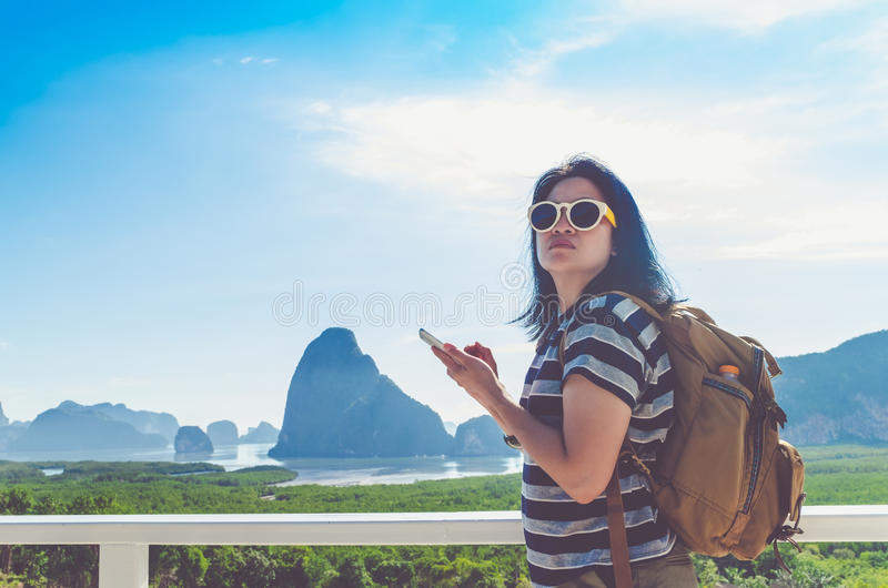 Young traveler woman find way direction with map on mobile phone royalty free stock photography