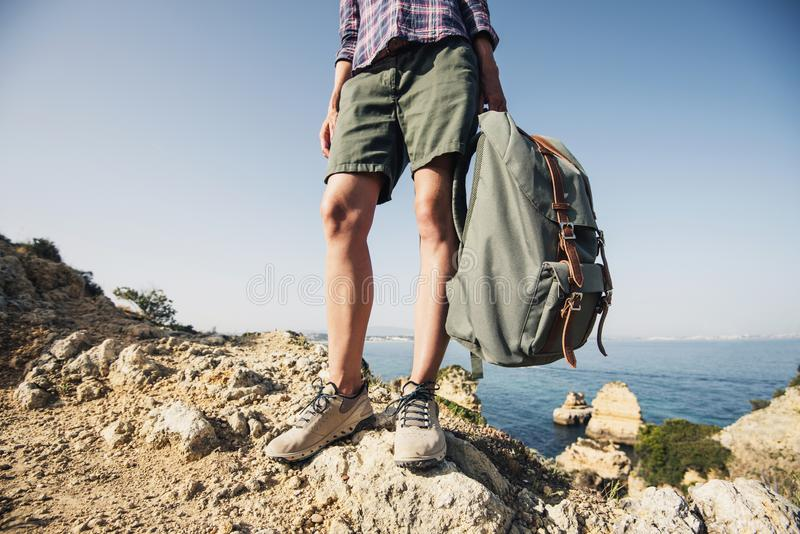 Young traveler woman holding backpack on a hiking trail, travel and active lifestyle concept stock images