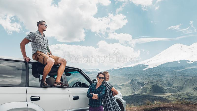 Young Travelers Friends Enjoys View Of Mountains In Summer stock photography