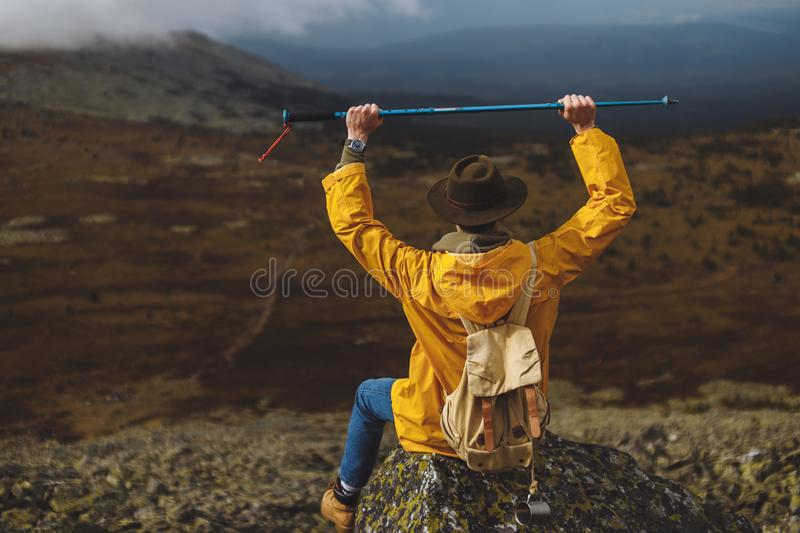 Young traveller holding a stick over his head stock photos