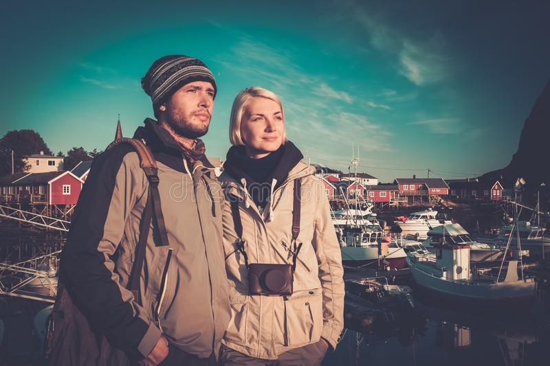 Young travellers. Couple in Reine village, Norway royalty free stock photography