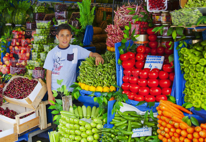 Download Young Turrkish Boy Holding Vegetable Stall Editorial Photography - Image of arrangement, fruit: 23111417