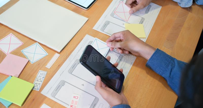 Young UI UX and his project. Close-up of young male UI UX designer`s hand working on their project royalty free stock images