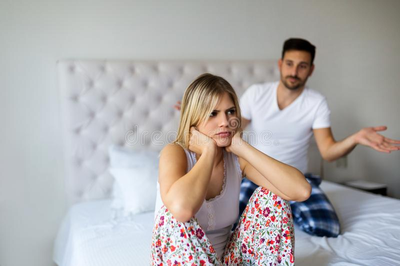 Young unhappy couple having problems in relationship stock image