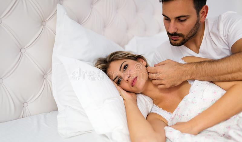 Young unhappy couple having problems in relationship stock photography