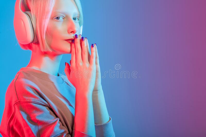 Young unhappy girl trying to reduce her stress and negative emotions stock photo