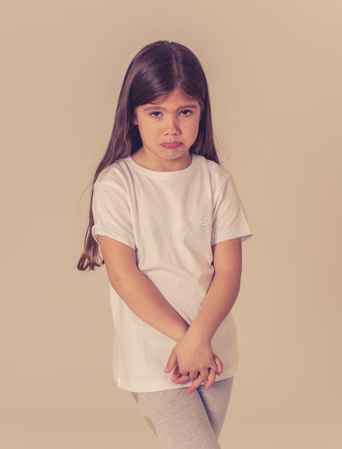 Young unhappy little girl making cute sad facial expression royalty free stock images