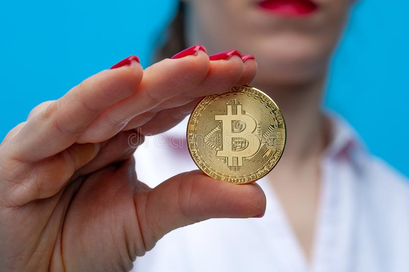 Young unidentified woman holding a bitcoin coin stock image