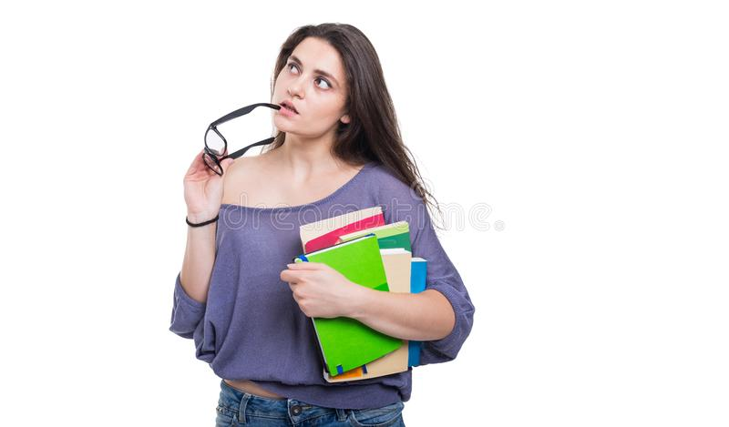 Young university student thinking and looking up stock images