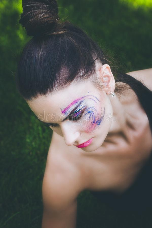 Young urban finess woman with artistic makeup outdoor portrait. Summer day royalty free stock photo