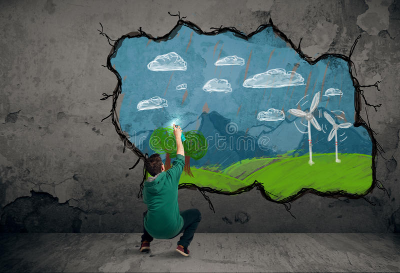 Young urban painter drawing. Colorful future image on the wall royalty free stock photo