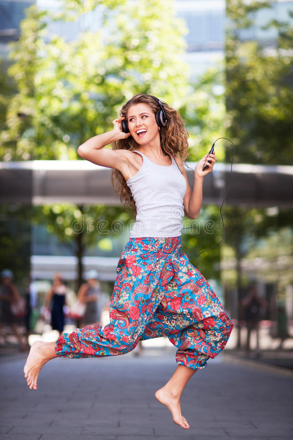 Download Young urban woman jumping stock photo. Image of lifestyle - 32835694
