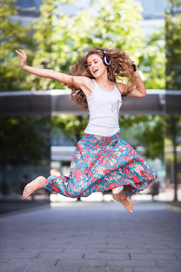 Download Young Urban Woman Jumping Stock Photos - Image: 32835703