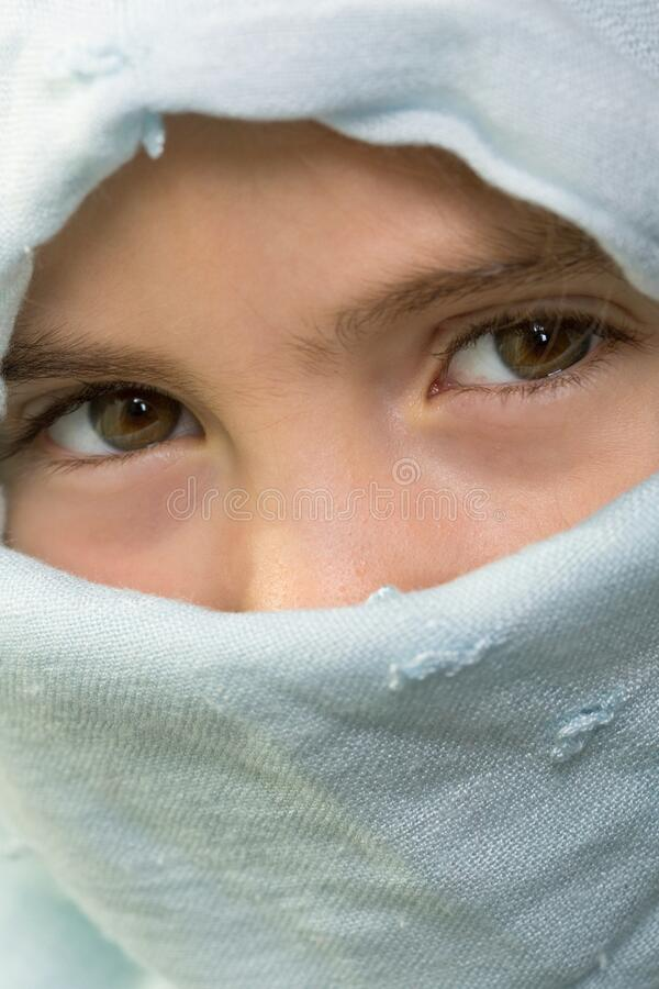 Young veiled girl stock images