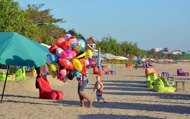 Young Vendor of Animal Shaped Balloons at Legian Beach royalty free stock photos