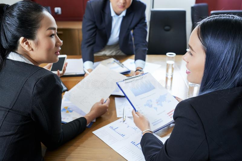 Business people working with documents stock image