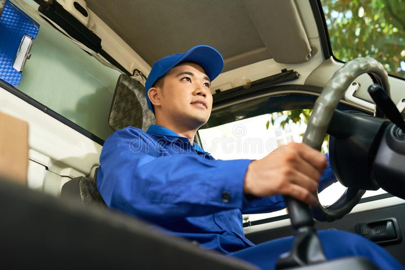 Delivery man driving van royalty free stock photography