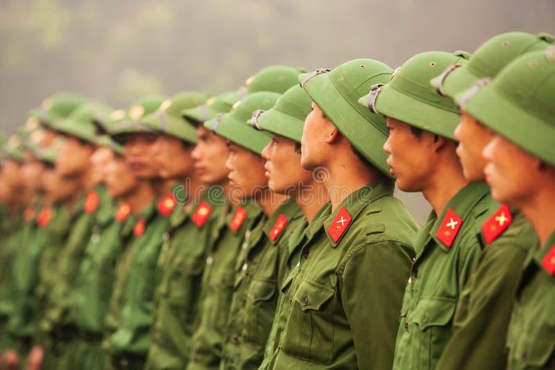 Young Vietnamese soldier during site visit program of Vietnamese. Dien Bien Phu, Vietnam – FEBRUARY 26, 2012: Young Vietnamese soldier during site visit royalty free stock image