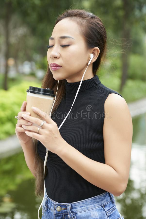 Woman enjoying smell of coffee royalty free stock image