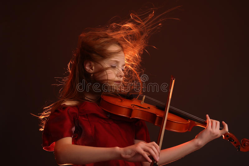 Young violinist royalty free stock photos