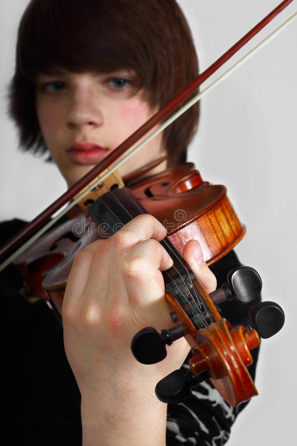 Young violinist stock photos