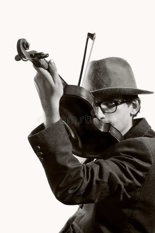 Young violinist playing to violin stock photography