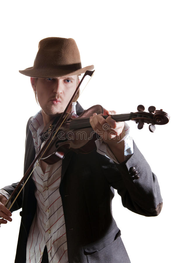 Young violinist playing the violin in hat stock images