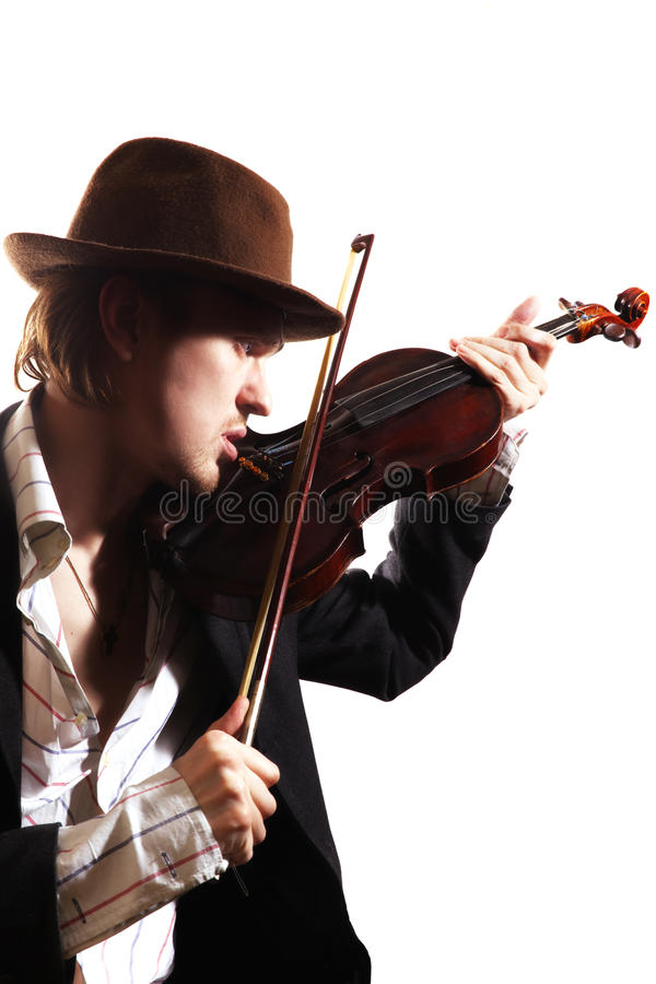 Young violinist playing the violin in hat a royalty free stock image