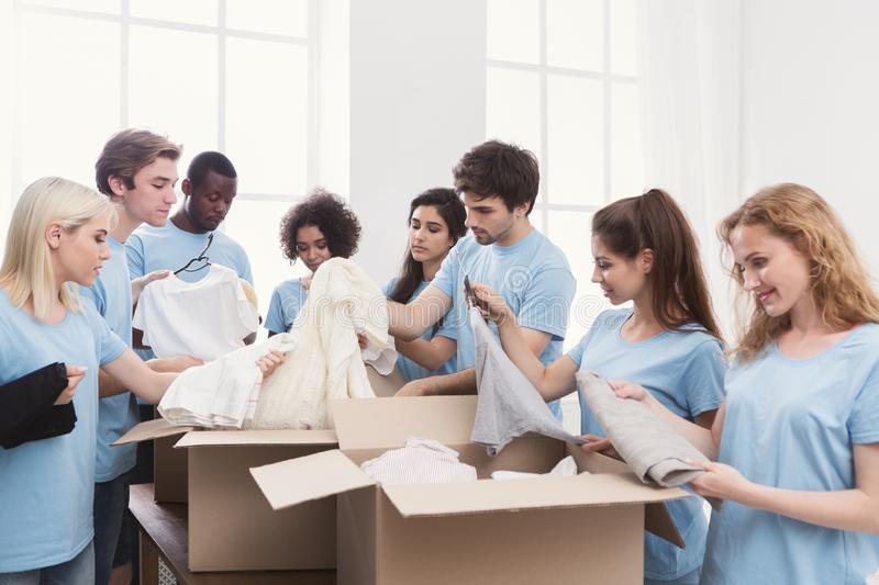 Young volunteers group working with clothing donation royalty free stock photography