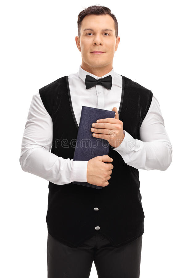 Young waiter holding a menu royalty free stock images