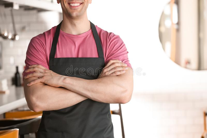 Young waiter in uniform royalty free stock photography