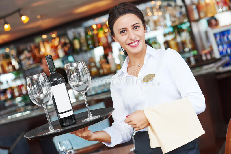 Young waitress at service in restaurant royalty free stock photo