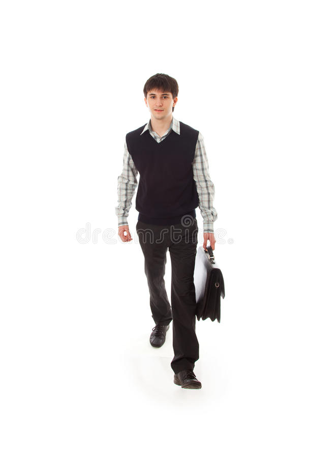 The young walking businessman isolated on a white royalty free stock photography