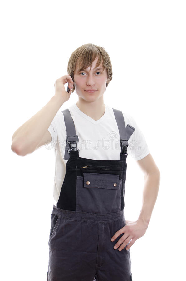 Download Young Warehouse Worker Calling By Mobile. Stock Photo - Image: 23967912
