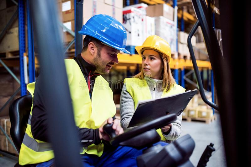 Young warehouse workers working together. stock images