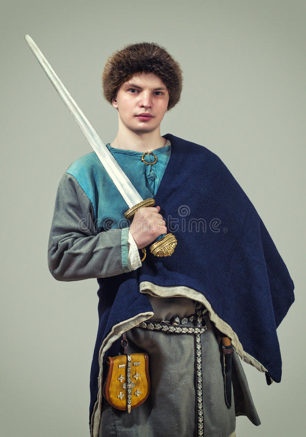 Young warrior of the early middle ages. stock photos